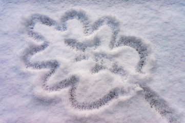 Waiting for spring, oak leaf symbol drawn in snow