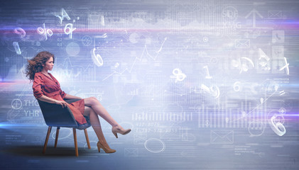 Elegant woman sitting in a sofa with numbers and reports concept