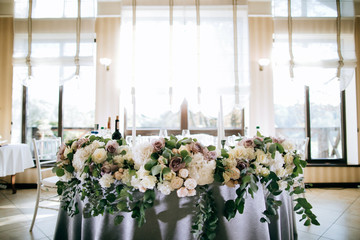 Wedding table for brides decorated with fresh flowers