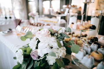 Wedding decorations from fresh flowers on the dessert table