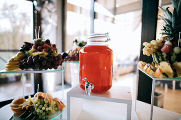 A bottle of cold drink on the wedding table. Catering servise