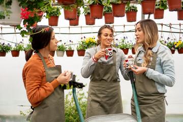 Smiling florists having a tea brake