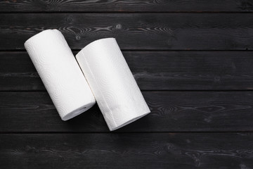 Roll of paper towel on wooden background