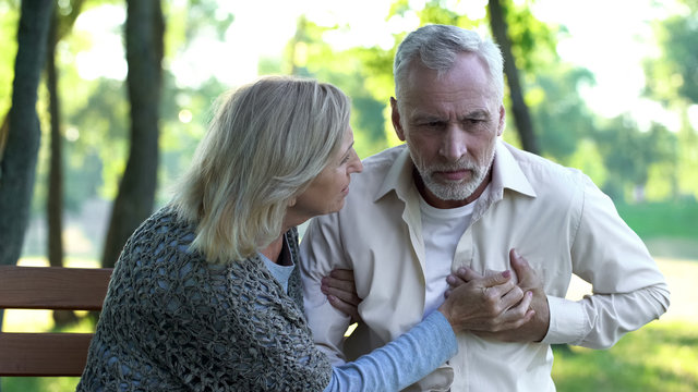 Healthcare, pensioner suffering from strong chest pain, heart attack risk