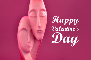 Happy Valentine Day illustration. Love faces stock images. Loving couple decoration. Couple statue isolated on a red background. Man and woman statue. Face of man and woman