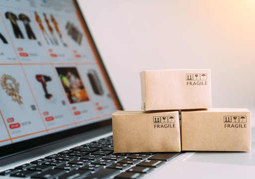 Online shopping or ecommmerce delivery service concept,Paper box on a laptop computer ,Easy shopping online concept