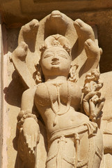 Erotic sculpture at Vishvanatha Temple at the  Western temples of Khajuraho in Madhya Pradesh, India. UNESCO World heritage site.