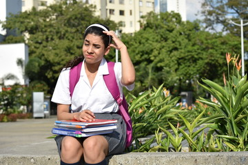 Cute Colombian Girl Student And Confusion Sitting