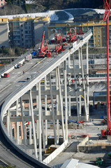 Construction workers dismantle the collapsed Morandi Bridge in Genoa