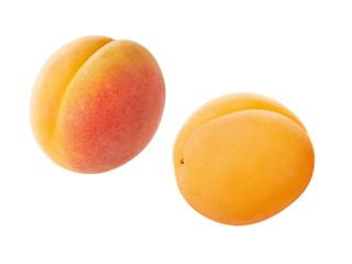 zwei ganze Aprikosen