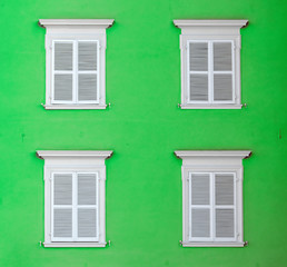 wooden shutter in white color gives a harmonic background