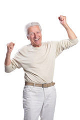 Happy senior man posing on white background