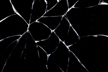 cracks in glass are isolated on a black background