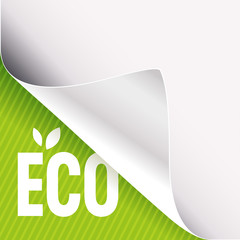 Curled white paper corner on green and Eco sign