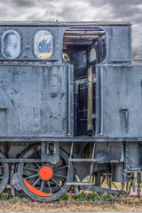 Detailed view of a old cab control train, cloudy sky as background