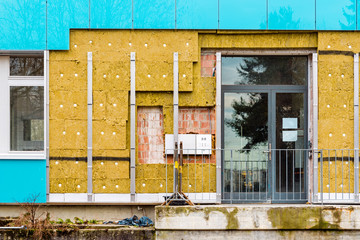 thermal insulation on new building, construction site, facade with mailbox