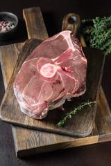 Raw deer meat on wooden Board