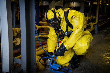 Rescuers in a radiation protection suit.