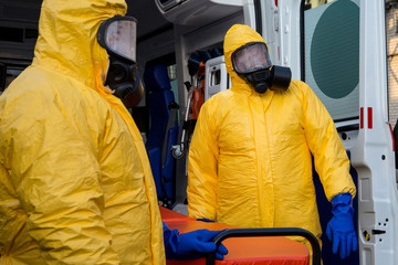 Rescuers in a suit of chemical and biological protection.