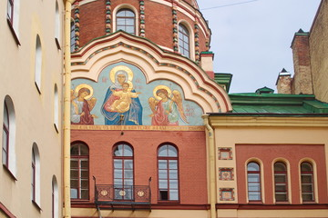 Image of a fragment of the facade of the Church of St. John the theologian with the icon of the Mother of God, St. Petersburg, Russia