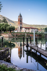 ticino, old church on the canal near Caslano and ponte tresa, between italy and switzerland, europe