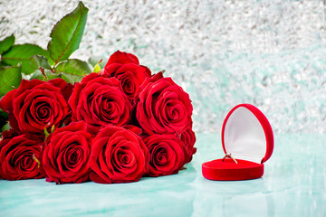 Red roses with boke background. box with a ring. copy space. 8 March Women s Mother Day