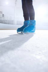 close up view of figure skater on dark ice arena background