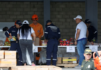 Firefighters organise humanitarian aid for Venezuela at a warehouse near the Tienditas cross-border bridge between Colombia and Venezuela in Cucuta