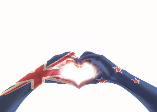 New Zealand flag on people heart shaped hands isolated on white background (clipping path) for NZ national public holiday celebration...