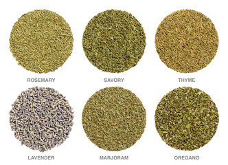 Culinary herbs for Herbes de Provence. Herbal circles. Dried rosemary, savory and thyme are always used, lavender, marjoram and oregano is often added. Closeup, macro food photo, on white background.