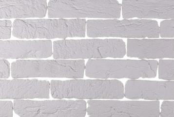 white decorative brick wall of white brick on a white background