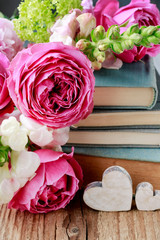 Old books and bouquet of flowers.