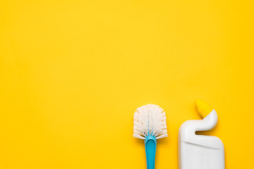 Home cleanup. Basic toilet cleaning kit. Copy space on yellow background.