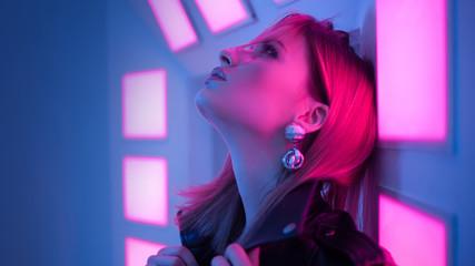 Futuristic style portrait in blue and purple light.