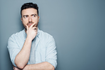 Thoughtful man portrait isolated on background
