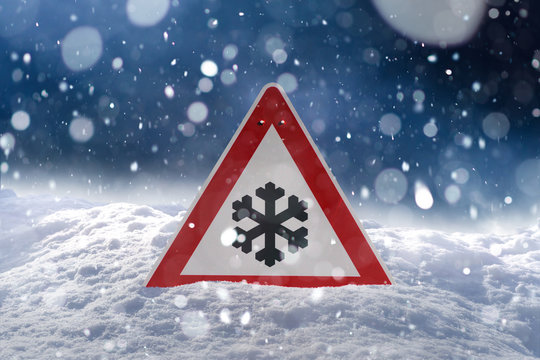winter driving - risk of snow and ice - traffic sign