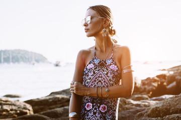 Model in ethnic monokini and wearing boho jewellery