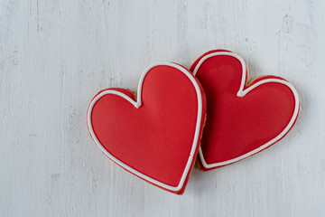 Red Heart-shaped cookies with icing detail on white background