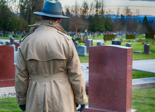 Man mourns at cemetery