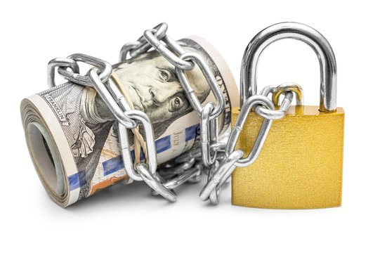 Dollar bills wrapped by chain and secured with padlock. Isolated on white. Safety money and investment concept.