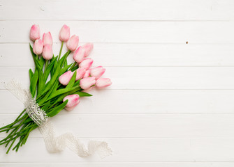 tulips on white wooden background