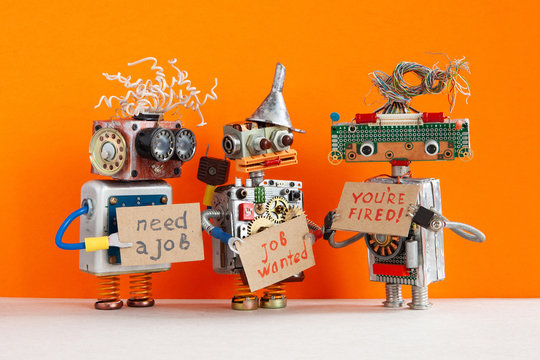 Automated dismissal and hiring of staff. The relationship between employer and employee. robot boss dismisses personnel and shows cardboard You are fired. Two unemployed robots looking for a new job