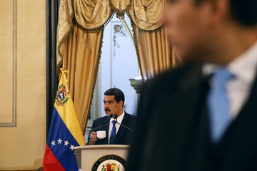 Venezuela's President Nicolas Maduro holds a cup during a news conference at Miraflores Palace in Caracas