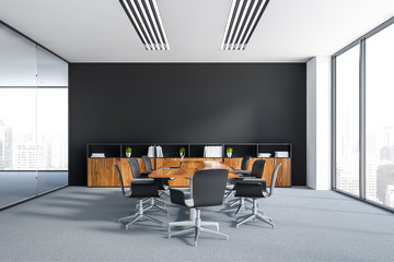 Black meeting room with wooden table