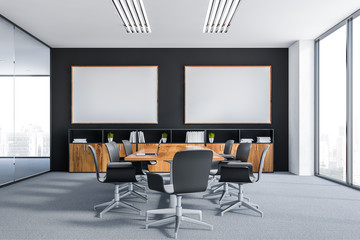 Black meeting room with two posters