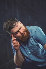 Cheerful bearded man greets by taking off a hat - studio shots