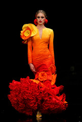 A model presents a creation by Ana Moron during the International Flamenco Fashion Show SIMOF in the Andalusian capital of Seville