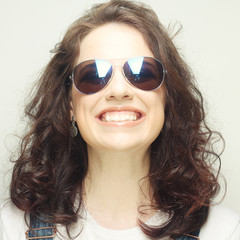 curly woman with sunglasses