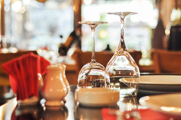 Luxury table settings for fine dining with and glassware. Beautiful blurred background. Wine glasses and plate on table..