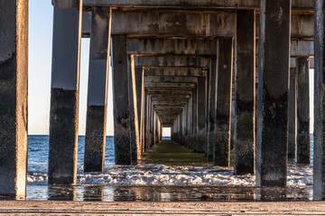 Under a pier at the beach.